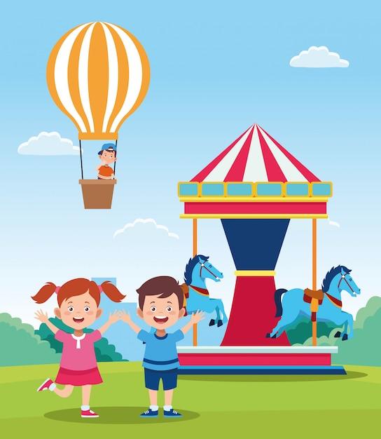 Счастливый день детей дизайн с мультфильм счастливые дети и карусель Premium векторы