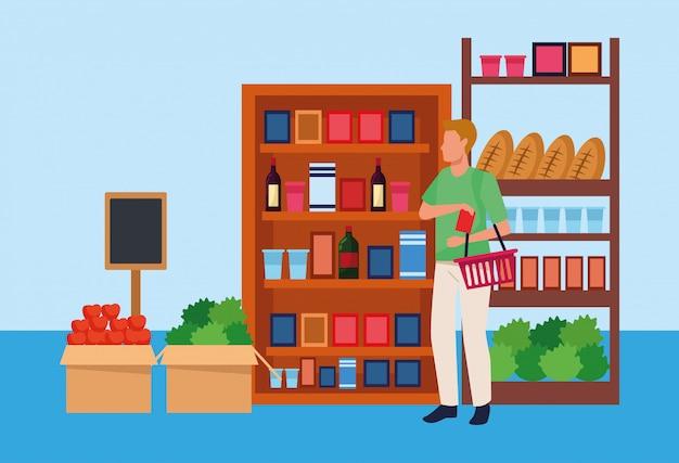 スーパーマーケットのアバター男は野菜や食料品で立っています。 Premiumベクター