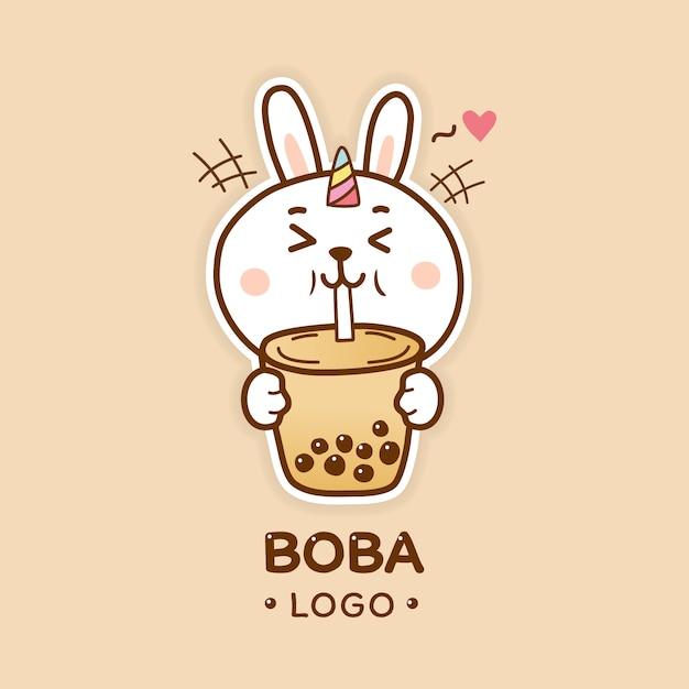 Милый кролик-единорог пьет пузырь чайный боба логотип мультфильма ничья рука Premium векторы