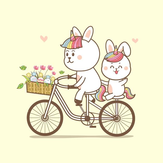 Милые кролики единорог езда на велосипеде Premium векторы