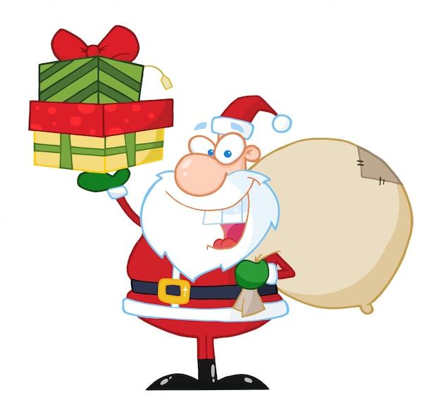 サンタは贈り物のスタックを保持 Premiumベクター