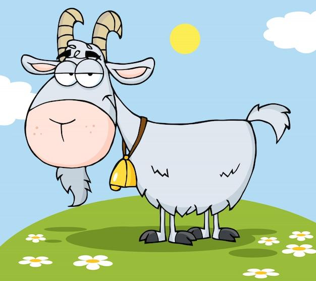 丘の上にヤギの漫画のキャラクター Premiumベクター