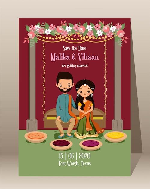 Сохраните дату. милый индийский жених и невеста с традиционной свадебной пригласительной картой Premium векторы