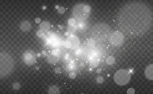 美しい火花が特別な光で輝きます。透明な背景の上で輝きます。 Premiumベクター