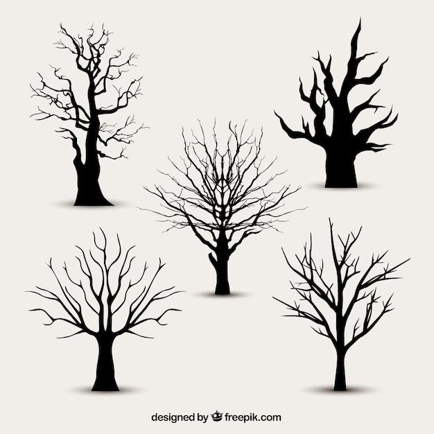 Силуэты деревьев без листьев Бесплатные векторы