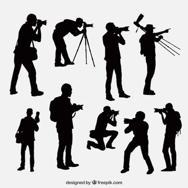 異なる位置でカメラマンのシルエット 無料ベクター