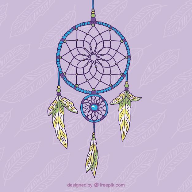 紫色の背景の上に手描きの装飾的な夢のキャッチャー 無料ベクター