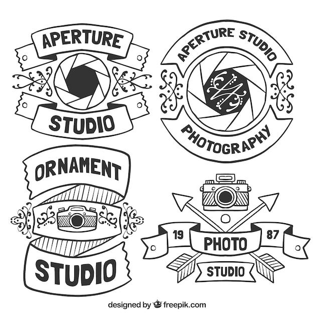 フォトスタジオのための美しい手描きのロゴ 無料ベクター