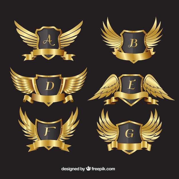 Пакет золотых гребней с крыльями Бесплатные векторы