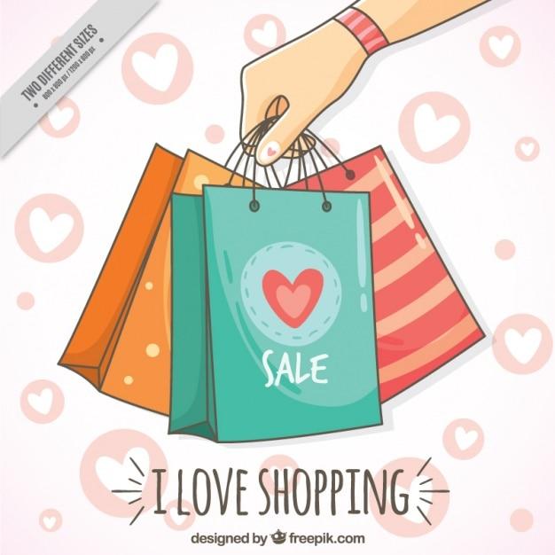 ショッピングバッグと心とかわいい背景 無料ベクター