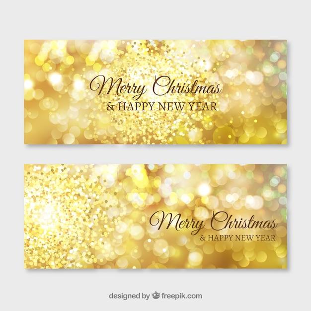 メリークリスマスと新年のための黄金の光沢のあるバナー 無料ベクター