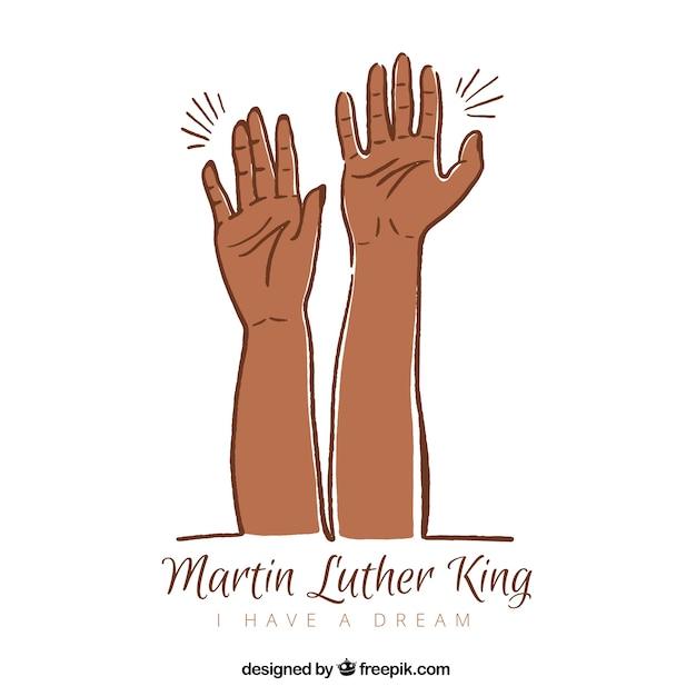 両手で手描きのマーティン・ルーサー・キングの日の背景 無料ベクター