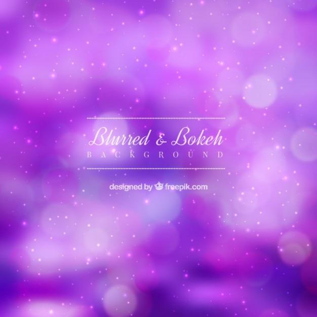 Фиолетовый размытый фон с эффектом боке Бесплатные векторы