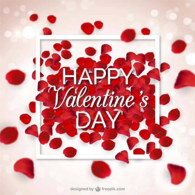 バレンタインデーのための赤い花びらと背景をぼかした写真 無料ベクター