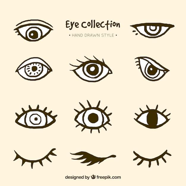 Коллекция рисованной глаз Бесплатные векторы