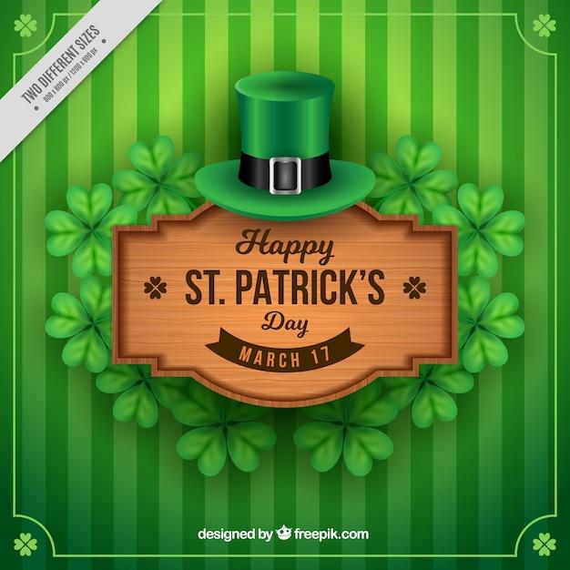 Зеленый полосатый фон с деревянным знаком день святого патрика Бесплатные векторы