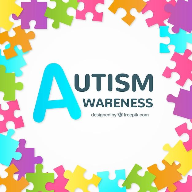 自閉症の日のカラフルなパズルのピースの背景 無料ベクター