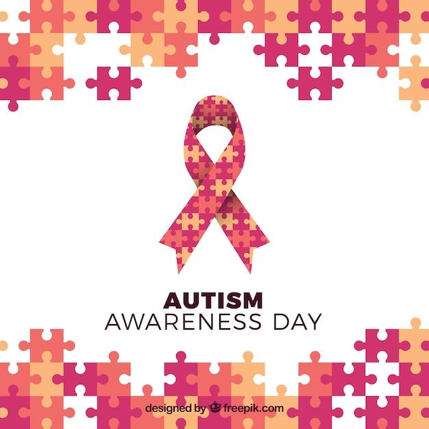 自閉症の日リボンとパズルの背景 無料ベクター