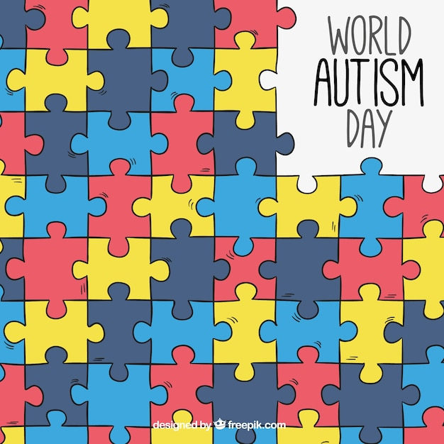 Аутизм день фон с красочными кусочками головоломки Бесплатные векторы