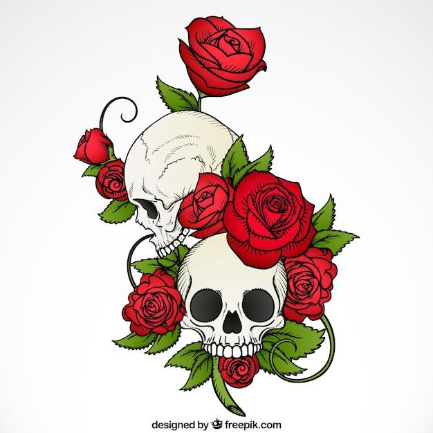 Фон руки обращается черепа с розами и листьями Бесплатные векторы