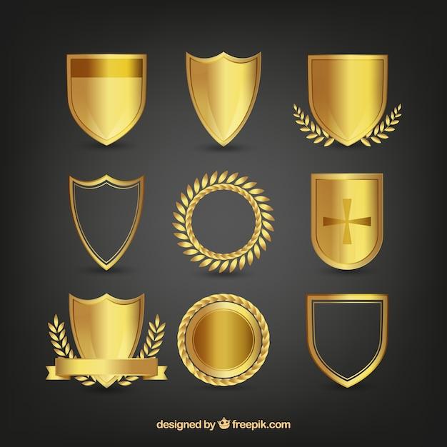 飾りと黄金の盾のパック 無料ベクター