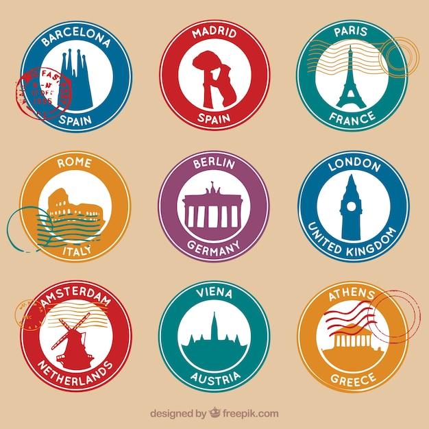 Набор круглых марок с девятью различными городами Бесплатные векторы