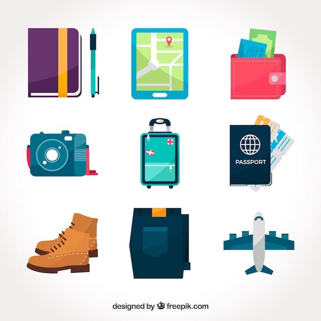 平らなデザインの他の旅行要素を備えた荷物パック 無料ベクター