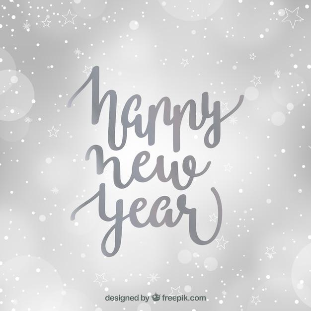Сфокусированный серебристый фон с новым годом Бесплатные векторы