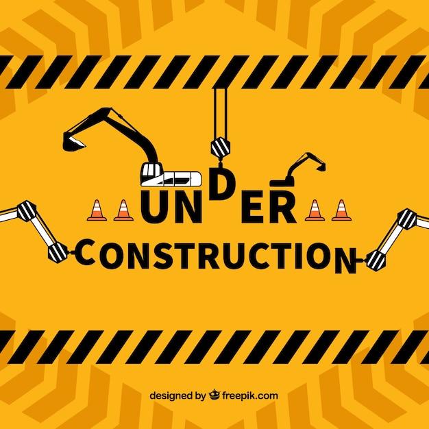 建設用テンプレートの下に描かれた手 無料ベクター