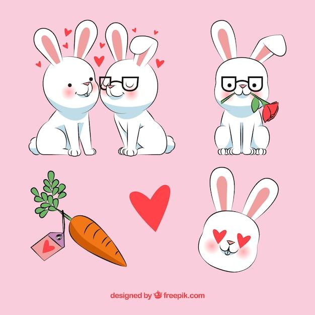 愛らしいウサギの手描きの素敵なセット 無料ベクター