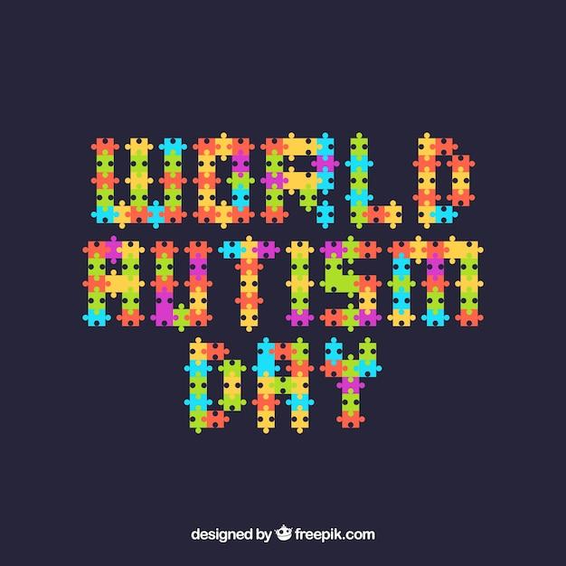 フラットスタイルのパズルピースを持つ世界自閉症の日の背景 無料ベクター