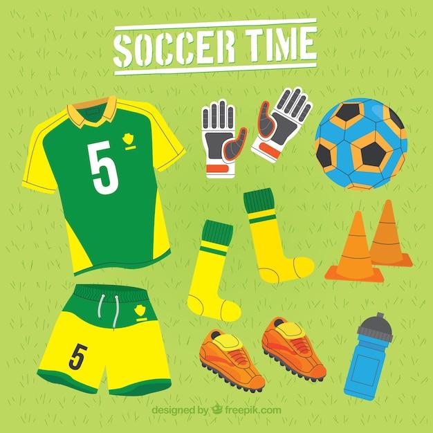 フラットスタイルの装備によるサッカーの要素のコレクション 無料ベクター