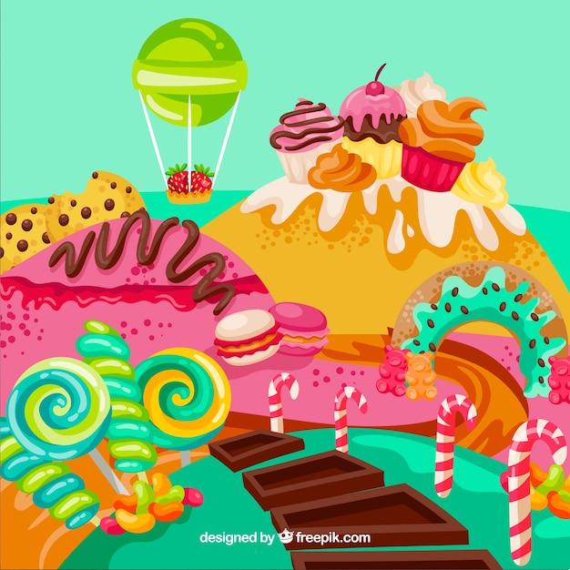 手描きのスタイルでカラフルなキャンデーの土地の背景 無料ベクター