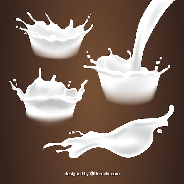 Коллекция свежих брызг молока в реалистичном стиле Бесплатные векторы