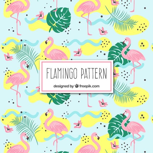 手で植物とフラミンゴのパターン描画スタイル 無料ベクター