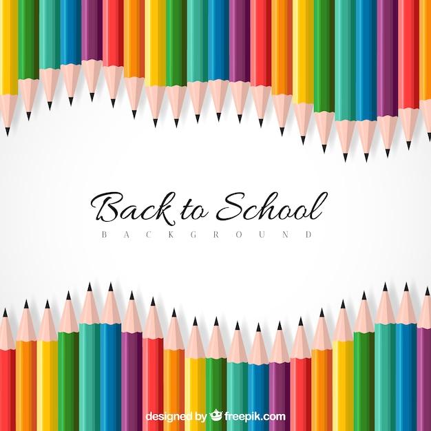 Снова в школу фон с красочными карандашами Бесплатные векторы
