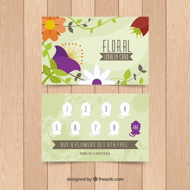 花のスタイルとカラフルなロイヤリティカードのテンプレート 無料ベクター
