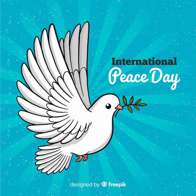 手で描かれた鳩と平和の日の背景 無料ベクター