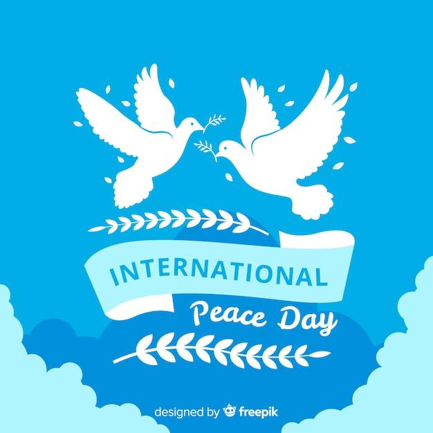 平らな白い鳩と平和の構成の日 無料ベクター