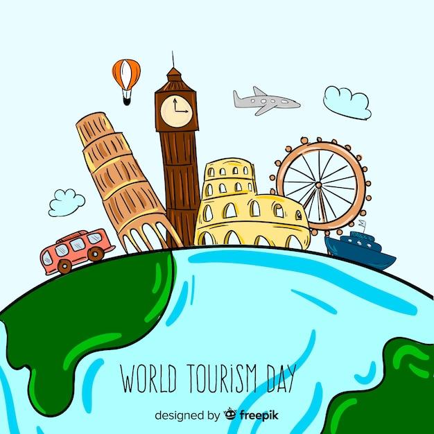 手描きの世界の観光日の概念 無料ベクター