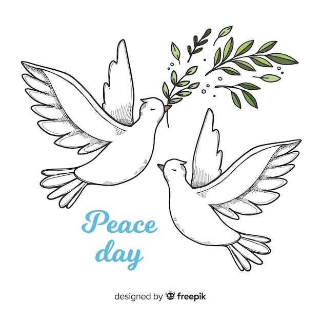 世界平和の日の背景に手描きのスタイルで鳩 無料ベクター