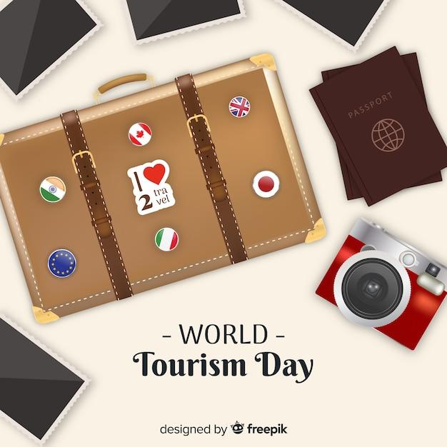 手荷物、パスポート、写真付きの世界観光一日の背景 無料ベクター