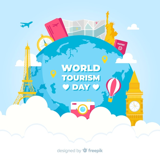 フラットデザインの世界とモニュメントを持つ観光日の背景 無料ベクター