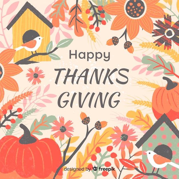 秋の要素を持つフラットデザインでの感謝祭の日の背景 無料ベクター