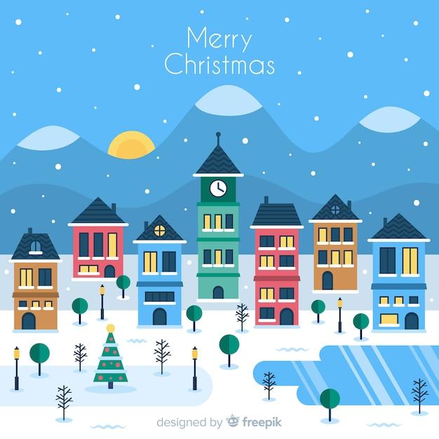 フラットデザインの素敵なクリスマスタウン 無料ベクター