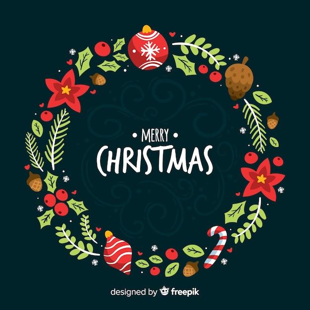 手はクリスマスの花輪の背景を描いた 無料ベクター