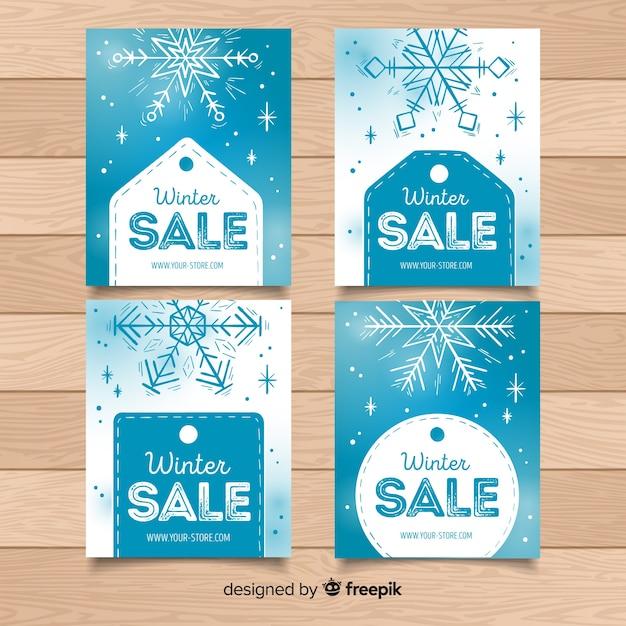 雪片とラベル冬のセールスカードコレクション 無料ベクター