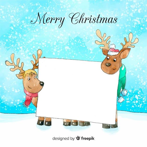 白い空のカードを保持するクリスマスの文字 無料ベクター