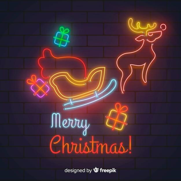 Счастливого рождества в неоновом стиле Бесплатные векторы