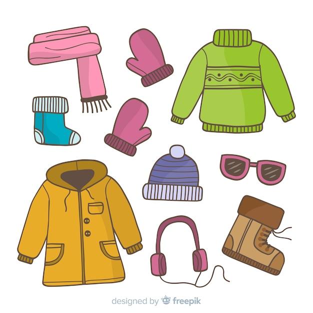 手描きの冬の服と本質 無料ベクター